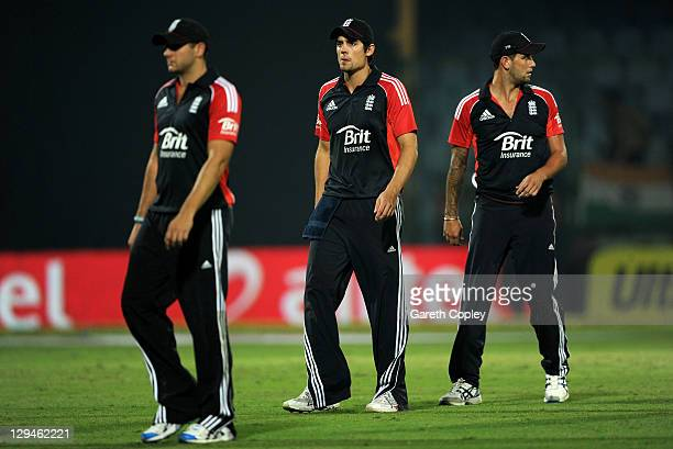 England captain Alastair Cook leaves the field alongside Tim Bresnan and Jade Dernbach after losing the 2nd One Day International between India and...