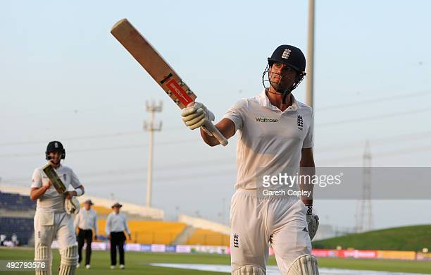 England captain Alastair Cook leaves the field at stumps on day three of the 1st Test between Pakistan and England at Zayed Cricket Stadium on...