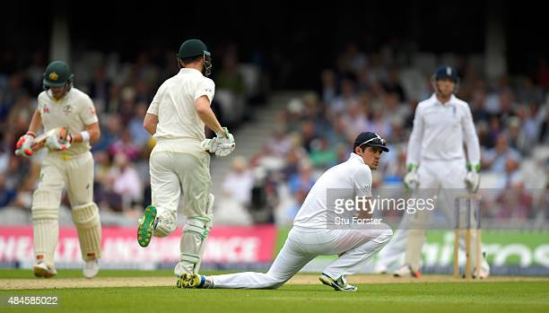 England captain Alastair Cook looks on as Australia batsmen Steve Smith and Adam Voges pick up some runs during day one of the 5th Investec Ashes...