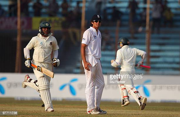 England captain Alastair Cook looks on as the Bangladesh batsmen pick up runs during day four of the 1st Test match between Bangladesh and England at...