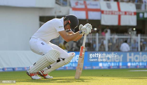 England captain Alastair Cook prepares to go out to bat during day four of the 3rd Test between Pakistan and England at Sharjah Cricket Stadium on...
