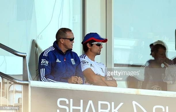 England captain Alastair Cook r0 and coach Andy Flower watch play from the players balcony during day one of 4th Investec Ashes Test match between...