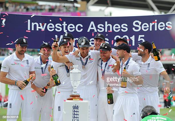 England Captain Alastair Cook raises the Ashes urn during the fourth day of the 5th Investec Ashes Test between England and Australia at The Kia Oval...