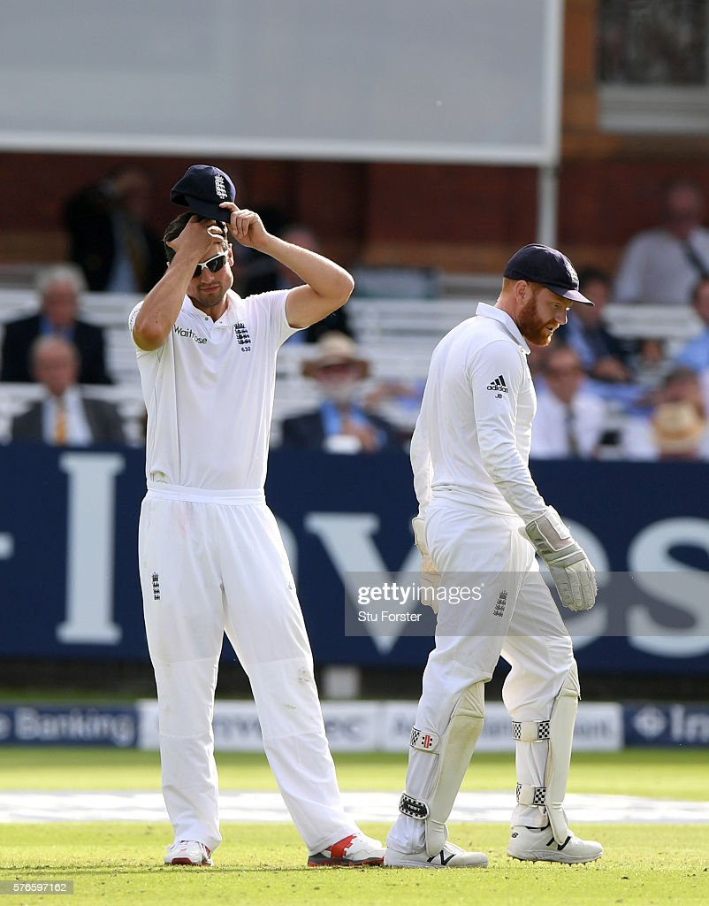 England captain Alastair Cook (l) reacts after wicketkeeper Jonny Bairstow had dropped a catch off Steven Finn during day three of the 1st Investec Test match between England and Pakistan at Lord's Cricket Ground on July 16, 2016 in London, England.
