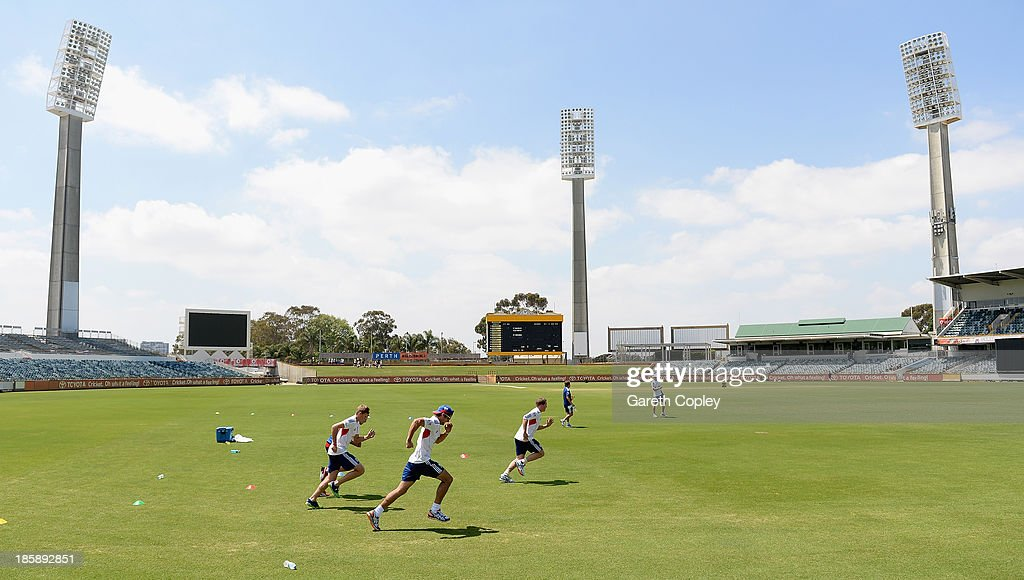 England captain Alastair Cook runs alondside Gary Ballance and Joe Root during a training session at WACA on October 26, 2013 in Perth, Australia.