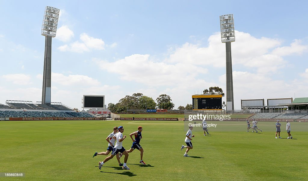 England captain Alastair Cook runs alondside Jonathan Bairstow, Gary Ballance and Joe Root during a training session at WACA on October 26, 2013 in Perth, Australia.