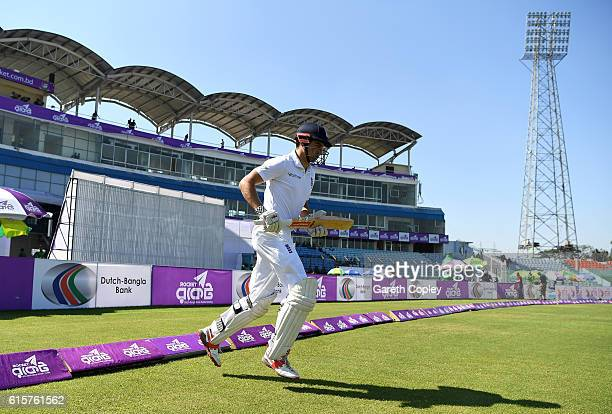 England captain Alastair Cook runs out for a record 134th time in test matches during the first Test match between Bangladesh and England at Zohur...