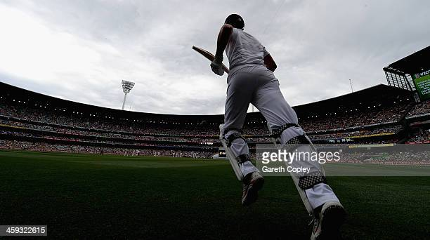 England captain Alastair Cook runs out to bat ahead of day one of the Fourth Ashes Test Match between Australia and England at Melbourne Cricket...