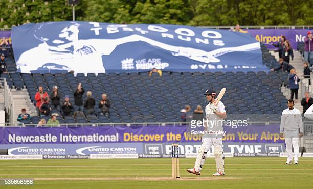England captain Alastair Cook salutes the crowd after reaching 10000 test runs during day four of the 2nd Investec Test match between England and Sri...