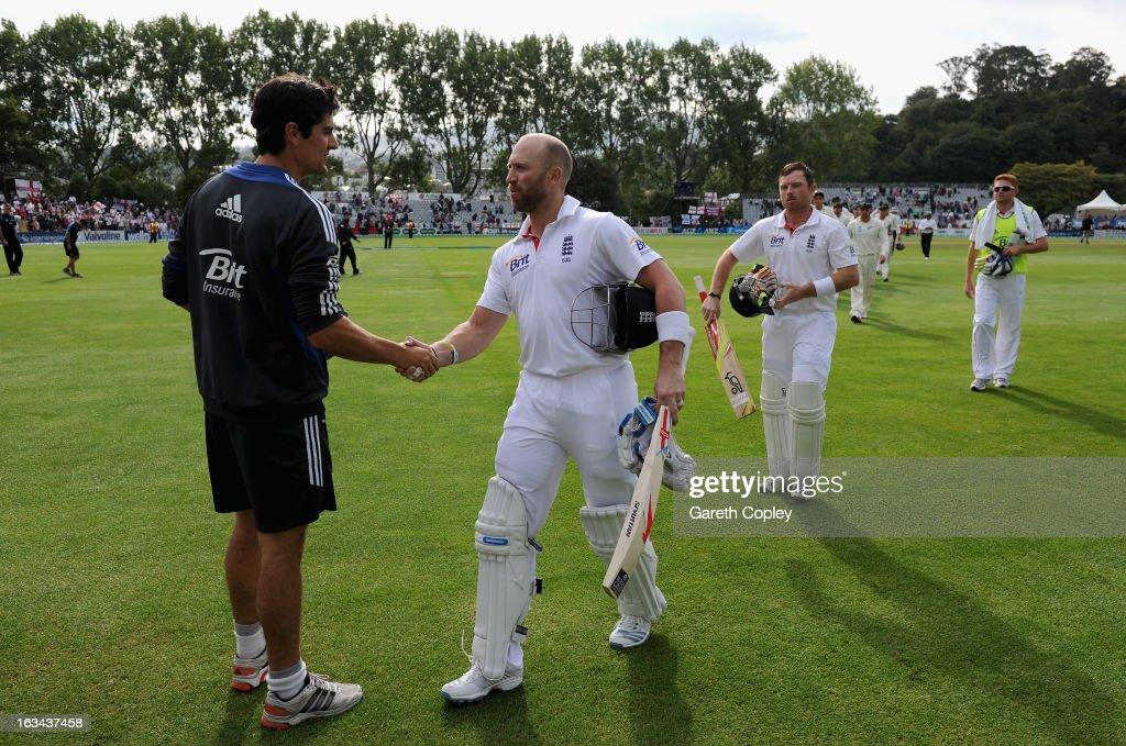 England captain Alastair Cook shakes hands with Matt Prior after drawing the First Test match between New Zealand and England at University Oval on March 10, 2013 in Dunedin, New Zealand.