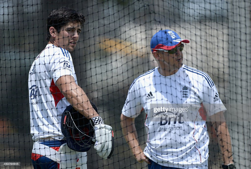 England captain Alastair Cook speaks with coach Andy Flower during an England nets session at The Gabba on November 18, 2013 in Brisbane, Australia.