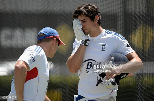 England captain Alastair Cook speaks with coach Andy Flower during an England nets session at WACA on December 11 2013 in Perth Australia