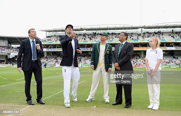 England captain Alastair Cook tosses the coin alongside Australian captain Michael Clarke ahead of day one of the 2nd Investec Ashes Test match...