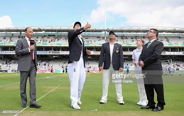England captain Alastair Cook tosses the coin alongside Mahendra Singh Dhoni of India ahead of day one of 2nd Investec Test match between England and...