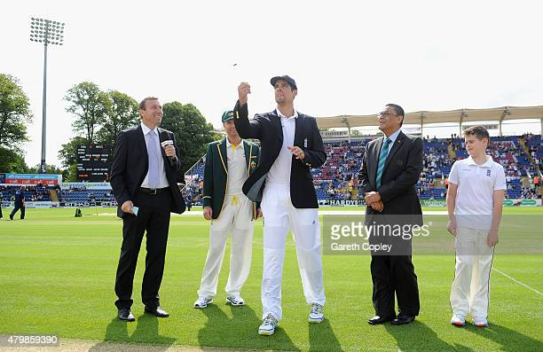 England captain Alastair Cook tosses the coin alongside Michael Clarke of Australia ahead of day one of the 1st Investec Ashes Test match between...