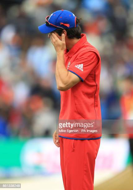 England captain Alastair Cook wipes his face as the rain falls during the ICC Champions Trophy Final at Edgbaston Birmingham