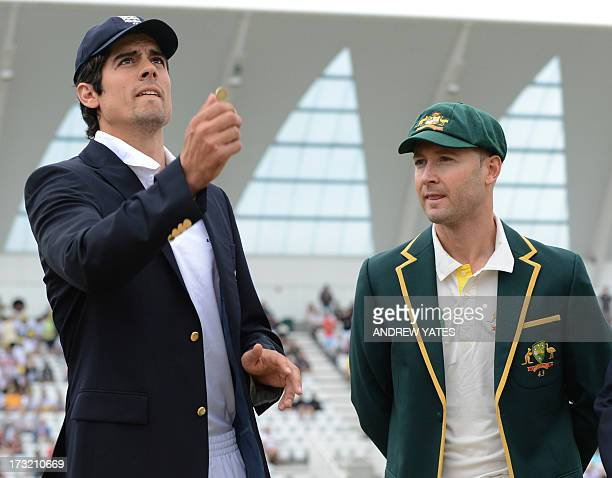England captain Alistair Cook tosses the coin as Australia's Michael Clarke looks on during the first days play of the first cricket Test match of...