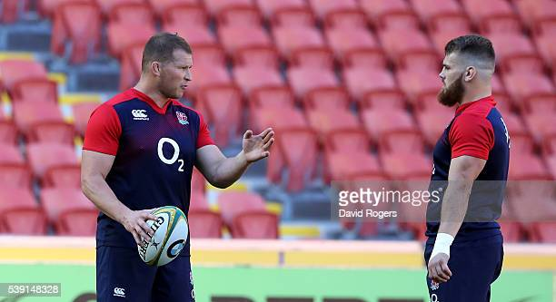 England captain and hooker Dylan Hartley talks to reserve hooker Luke CowanDickie duirng the England captain's run held at the Suncop Stadium on June...