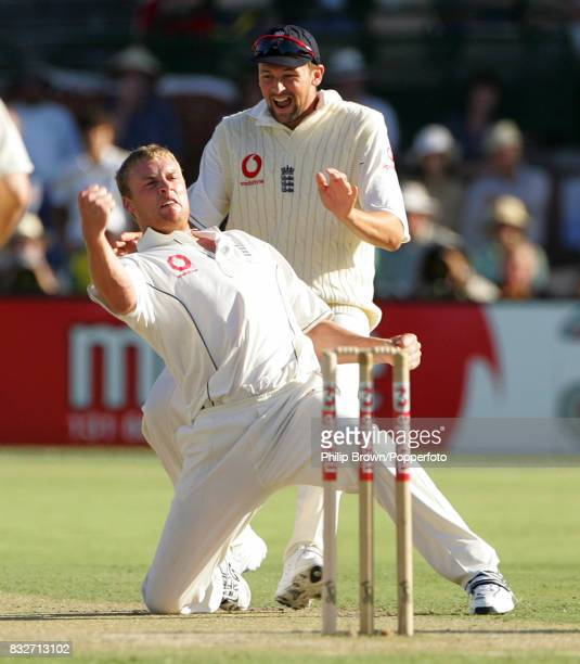 England captain Andrew Flintoff celebrates with Steve Harmison after getting the wicket of Australia's Justin Langer for 4 runs in the 2nd Test match...