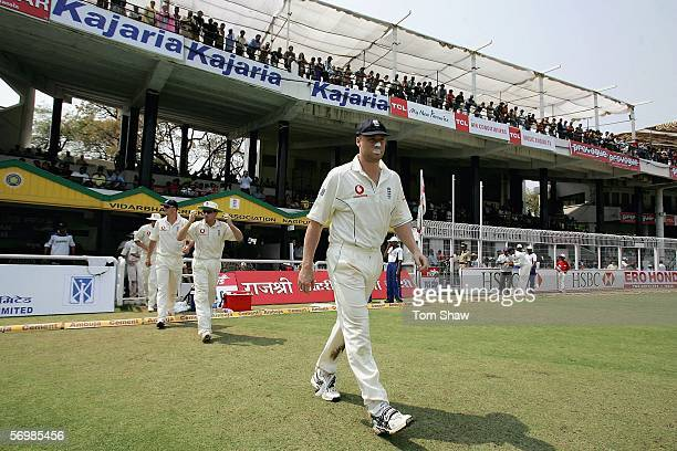 England captain Andrew Flintoff leads out the team during day three of the First Test between India and England at the VCA Stadium on March 3, 2006...