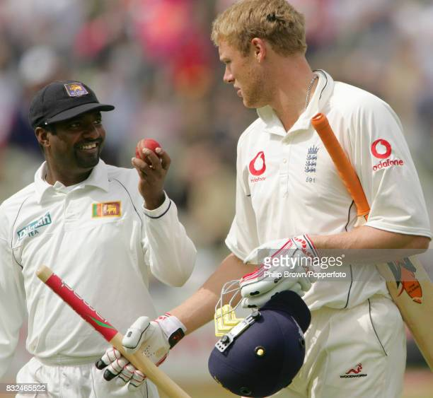 England captain Andrew Flintoff walks off the pitch with his souvenir stump as Sri Lanka's Muttiah Muralitharan shows him his 10-wicket match ball...