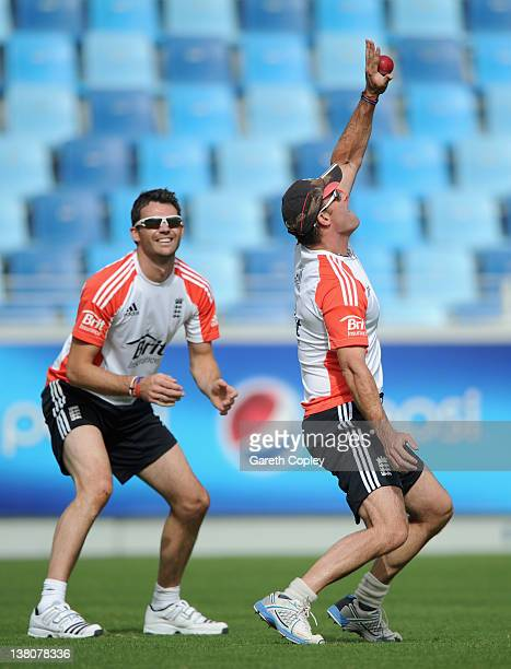 England captain Andrew Strauss and James Anderson take part in a fielding drill during a nets sessions at The Dubai International Cricket Stadium on...