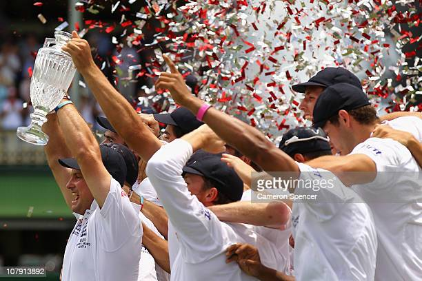 England captain Andrew Strauss and the England team celebrate with the Urn and Trophy after winning the Ashes series 31 during day five of the Fifth...