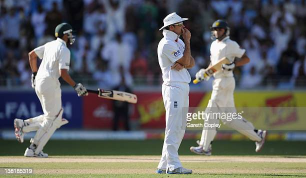 England captain Andrew Strauss looks on as Azhar Ali and Younis Khan of Pakistan score runs during the 3rd Test match between Pakistan and England at...