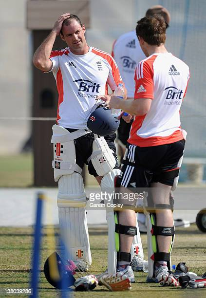England captain Andrew Strauss speaks with Eoin Morgan during a nets session at the ICC Global Cricket Academy on February 1 2012 in Dubai United...