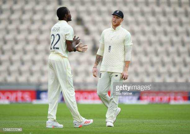 England captain Ben Stokes speaks with Jofra Archer during day two of the 1st #RaiseTheBat Test match at The Ageas Bowl on July 09 2020 in...