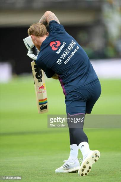 England captain Ben Stokes warms up displaying key workers names on his back ahead of day one of the 1st #RaiseTheBat Test match at The Ageas Bowl on...
