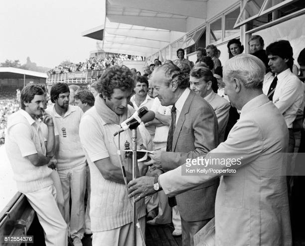 England captain Bob Willis is presented with the winner's cheque during the presentation ceremony after England beat Pakistan by 113 runs in the 1st...