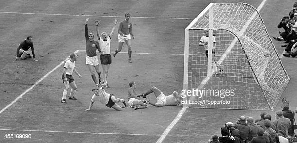 England captain Bobby Moore appeals for offside as Wolfgang Weber of West Germany scores past England goalkeeper Gordon Banks to level the score 22...