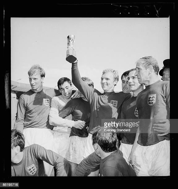 England captain Bobby Moore holds up the Jules Rimet trophy after his team's 42 victory over West Germany in the World Cup Final at Wembley Stadium...