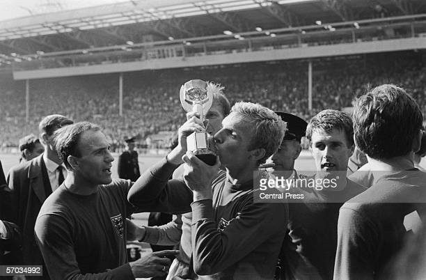 England captain Bobby Moore kisses the Jules Rimet World Cup trophy after England's 42 win over West Germany in the World Cup final at Wembley...