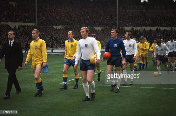 England captain Bobby Moore leads his team out before a friendly against Sweden at Wembley May 1968 Goalkeeper Alex Stepney is making his first and...