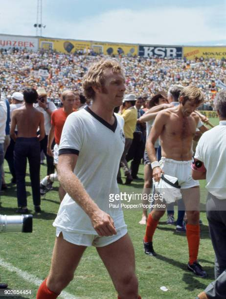England captain Bobby Moore leaves the field wearing a West German shirt after the FIFA World Cup quarter final match between West Germany and...