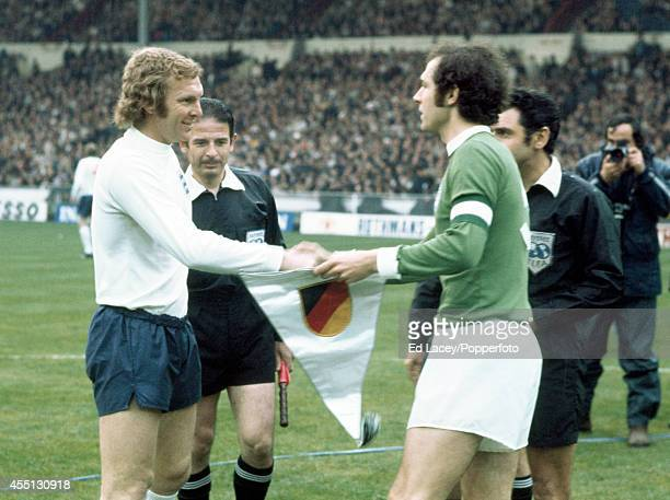 England captain Bobby Moore shakes hands with West Germany captain Franz Beckenbauer prior to their European Championship Qualifying 1st leg Match at...