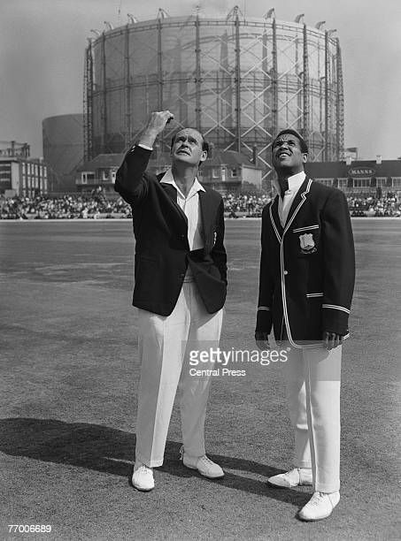 England captain Brian Close and West Indies captain Garfield Sobers tossing up before before the fifth and final test at the Oval, London, 18th...