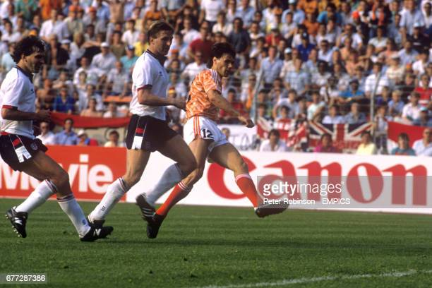 England Captain Bryan Robson and teammate Gary Stevens can only watch as Marco Van Basten scores his second goal for the game for the Netherlands