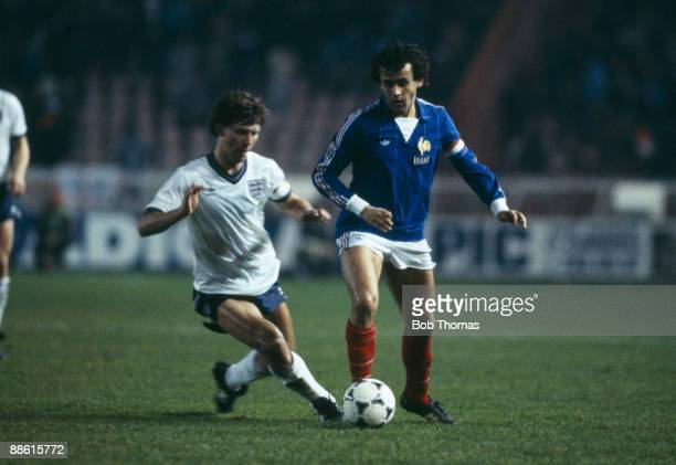 England captain Bryan Robson challenges Michel Platini of France during the International friendly at the Parcs des Princes Stadium in Paris 29th...