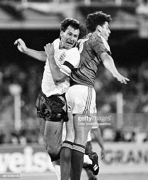 England captain Bryan Robson clashes with Andy Townsend of the Republic of Ireland during the FIFA World Cup match between England and the Republic...