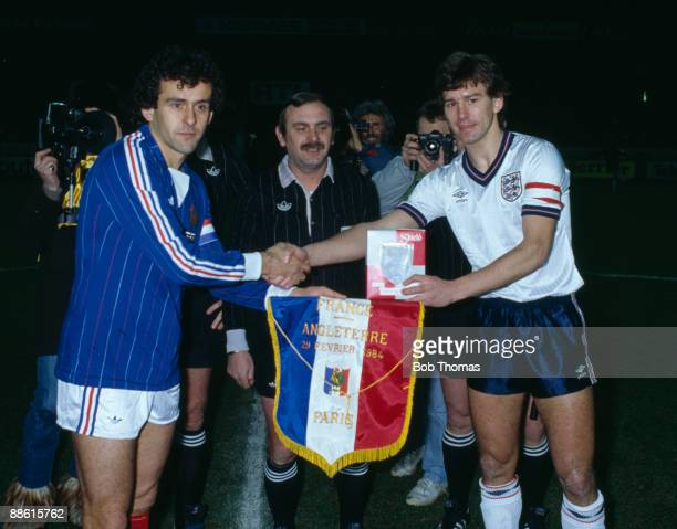 England captain Bryan Robson meets the French captain Michel Platini prior to the International friendly between France and England at the Parcs des...