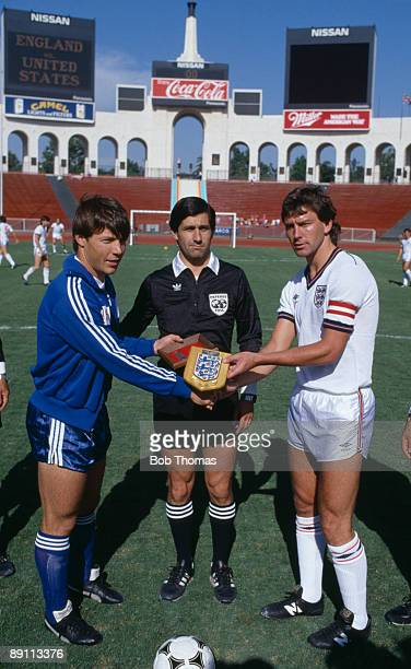 England captain Bryan Robson meets USA captain Rick Davis watched by referee Edgardo Codesal Mendez before the International friendly match at the...