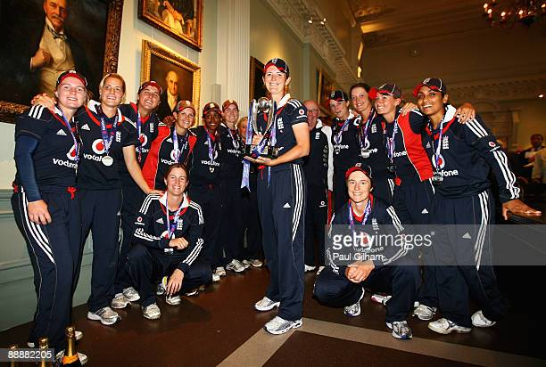 England captain Charlotte Edwards poses with her team-mates and the Natwest Trophy after England's series victory after play was abandoned due to a...