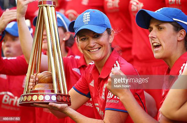 England captain Charlotte Edwards poses with the team and the trophy after game three of the Women's International Twenty20 series between Australia...