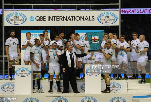 England captain Chris Robshaw lifts the match trophy after the QBE International match between England and Argentina at Twickenham Stadium on...