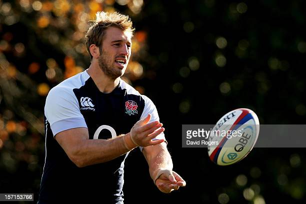 England captain Chris Robshaw passes the ball during the England training session at Pennyhill Park on November 29 2012 in Bagshot England