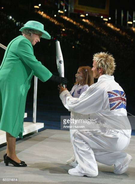 England captain David Beckham and Kirsty Howard hand the Queen's Jubille baton to Queen Elizabeth II after its final leg around the city of...