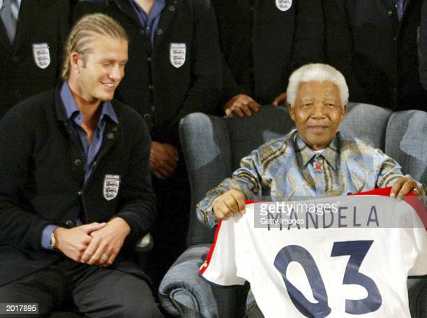 England captain David Beckham awards former South African President Nelson Mandela his own England Jersey on May 21 2003 at the Nelson Mandela...